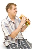 A young man with a big sandwich Royalty Free Stock Image