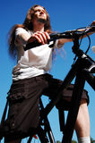 Young man on a bike. Young athletic guy on a mountain bike royalty free stock image