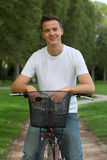Young man with a bike Stock Image