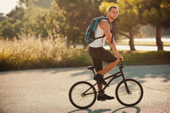 Young man on bike. Young man sitting on bike Stock Photography