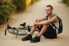 Young man on bike. Young man sitting on bike Stock Image