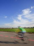 Young man with bike on the Tempelhof runway Stock Image