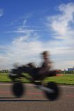 Young man with bike on the Tempelhof runway Stock Photography