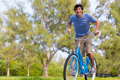 Young Man on bike wth trees Royalty Free Stock Photo