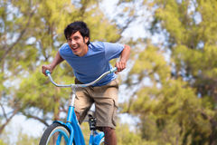 Young Man on bike wth trees Stock Image