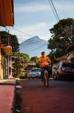 Young man bikes Granada city streets Royalty Free Stock Image