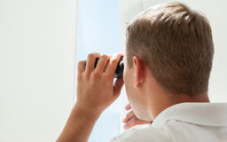 Young man with binocular Stock Photography