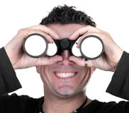 Young man with binoculars. On white background Stock Images