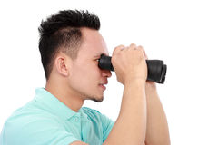 Young Man With Binoculars Royalty Free Stock Images