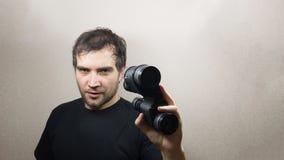Young man with binoculars Stock Photo