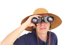 Young man with binoculars and straw hat Royalty Free Stock Images