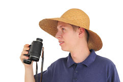 Young man with binoculars and straw hat. Young caucasian man with straw hat and binoculars Stock Photography