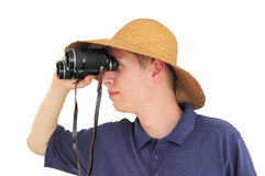 Young man with binoculars and straw hat. Young caucasian man with straw hat and binoculars Royalty Free Stock Photos