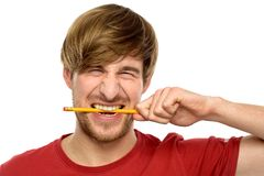 Young man biting a pencil Stock Photography