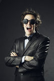 Young man bizarre screaming. Portrait of an elegant young man bizarre screaming stock photos