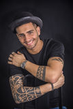 Young man with black bowler hat and tattoos Royalty Free Stock Photos