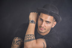 Young man with black bowler hat and tattoos Royalty Free Stock Images