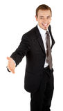 Young man in a black business suit Stock Image