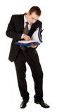 Young man in a black business suit Stock Images