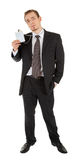 Young man in a black business suit and badge in hi Royalty Free Stock Photography