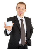 Young man in a black business suit and card Royalty Free Stock Images