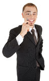 Young man in a black business suit and with a magn Royalty Free Stock Image