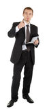 Young man in a black business suit with a notebook Royalty Free Stock Photos