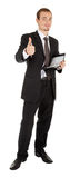 Young man in a black business suit with a notebook Royalty Free Stock Photography
