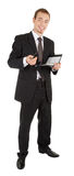 Young man in a black business suit with a notebook Stock Photo