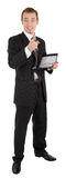 Young man in a black business suit with a notebook Stock Image