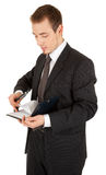 Young man in a black business suit with a notebook Stock Images