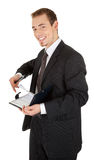 Young man in a black business suit with a notebook Royalty Free Stock Image