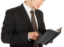 Young man in a black business suit with a notebook Stock Photos