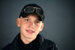 Young man in the black clothes, smiling Stock Photos