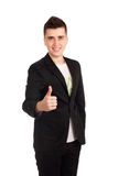 Young man in black coat show thumb up Royalty Free Stock Photos