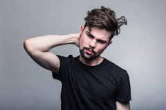 Young man in  black doubting Royalty Free Stock Photo