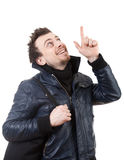 Young man in black jacket pointing up Stock Images