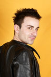Young man with black leather jacket Royalty Free Stock Photography
