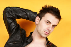 Young man with black leather jacket Royalty Free Stock Photos