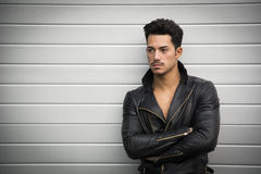 Young man with black leather jacket, arms crossed Royalty Free Stock Photo