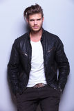 Young man with a black leather jacket smiling Royalty Free Stock Photography