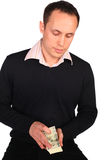 Young man in black with money Royalty Free Stock Photography