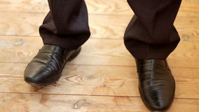 The young man in black pants and shoes tapping in the rhythm stock footage