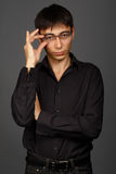 Young man in black shirt with glasses Royalty Free Stock Images