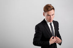 Young man in a black suit royalty free stock photo
