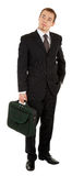 Young man in a black suit and carrying a bag in hi Royalty Free Stock Photography