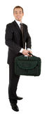 Young man in a black suit and carrying a bag in hi Stock Photography