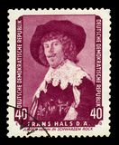 Young Man with black suit by Frans Hals. GERMANY - CIRCA 1959: Postage stamp printed in Germany, Democratic Republic DDR, shows Young Man with black suit by royalty free stock photos
