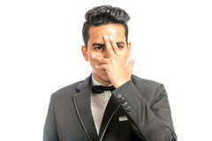 Young man in a black suit. With hand on his face isolated on white background Royalty Free Stock Photography