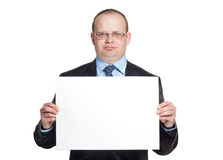 Young man holding a blank sheet of paper Royalty Free Stock Photography